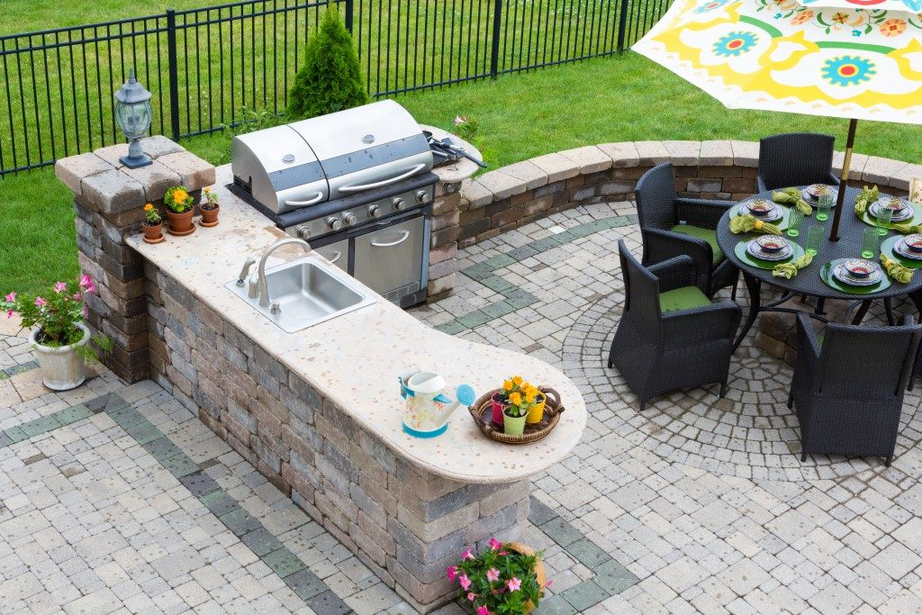 Backyard with outdoor kitchen and dining set