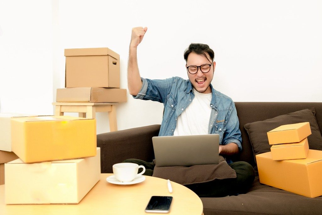 Man happy with boxes