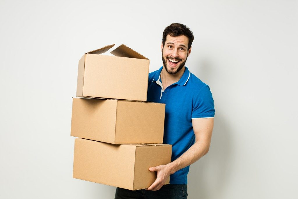 Man Happy with Moving Package
