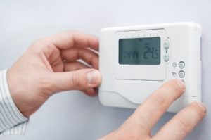 Man adjusting the temperature