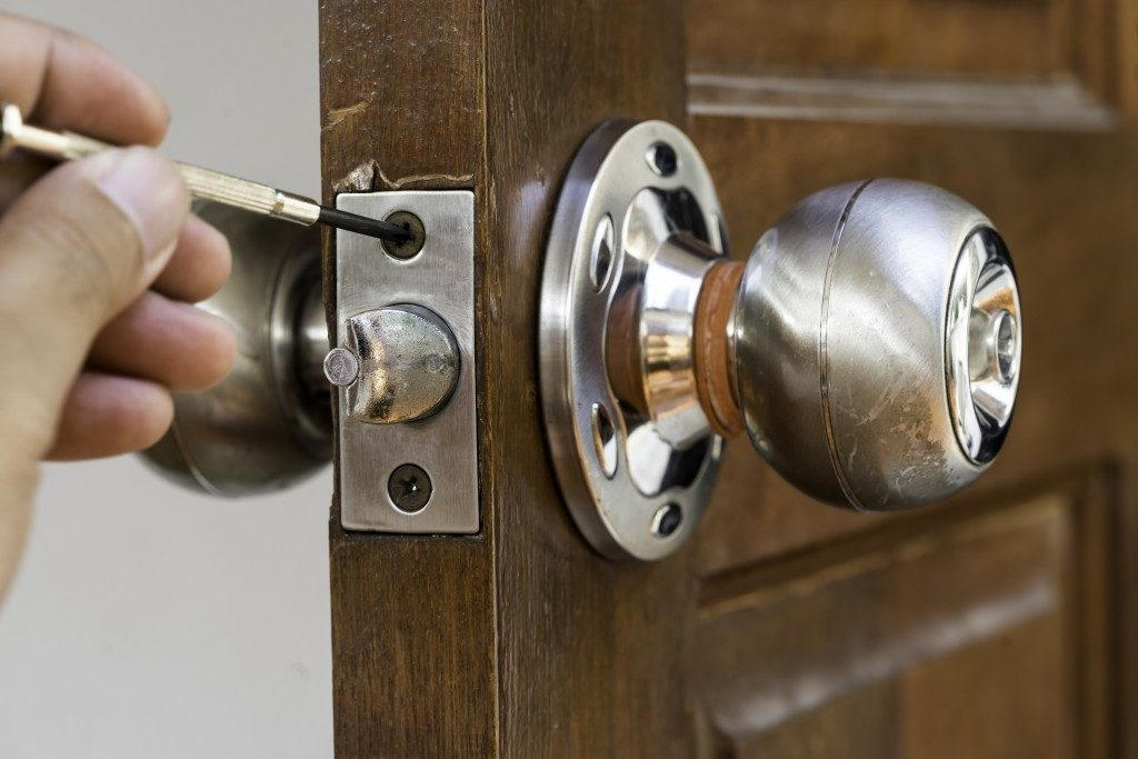 door knob being fixed