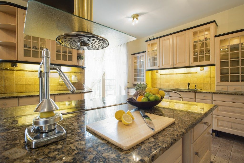 Granite counter top with chopping board and lemon