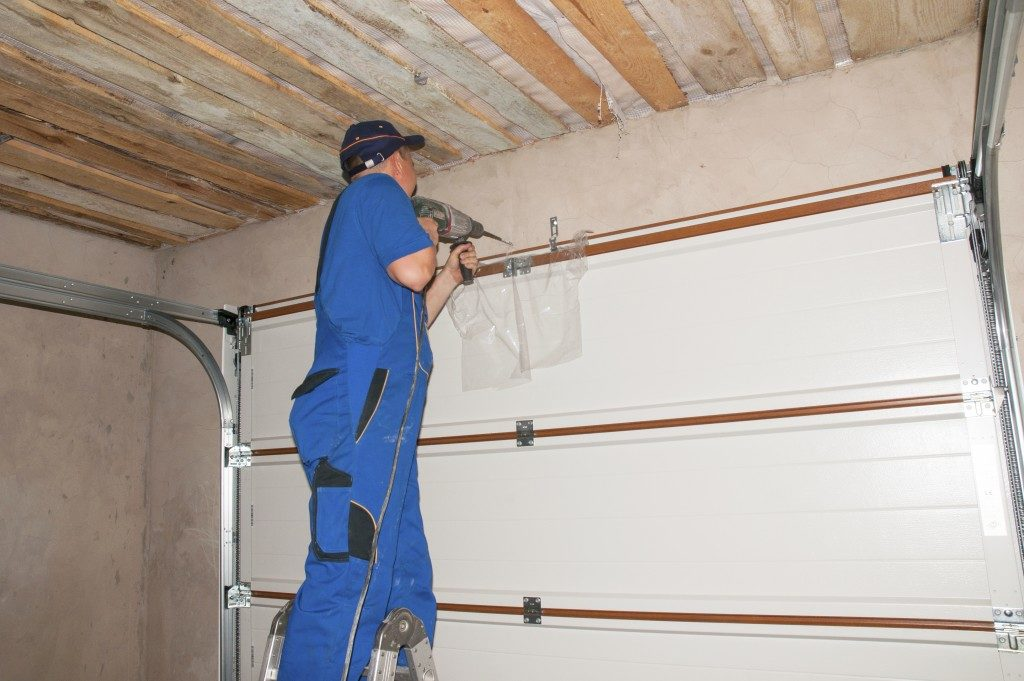 Man repairing a garage door