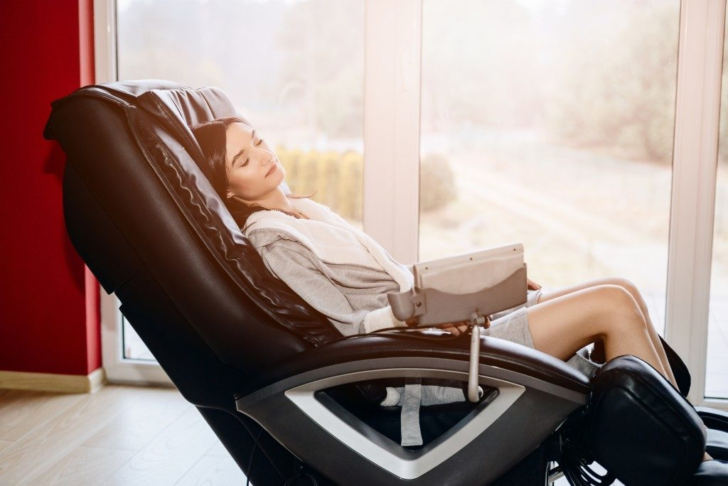 Woman sitting on the massage chair
