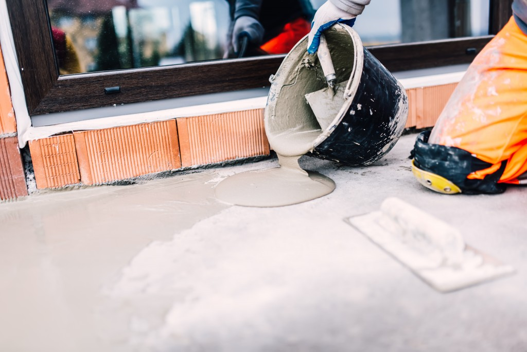 Worker pouring a sealant for waterproofing