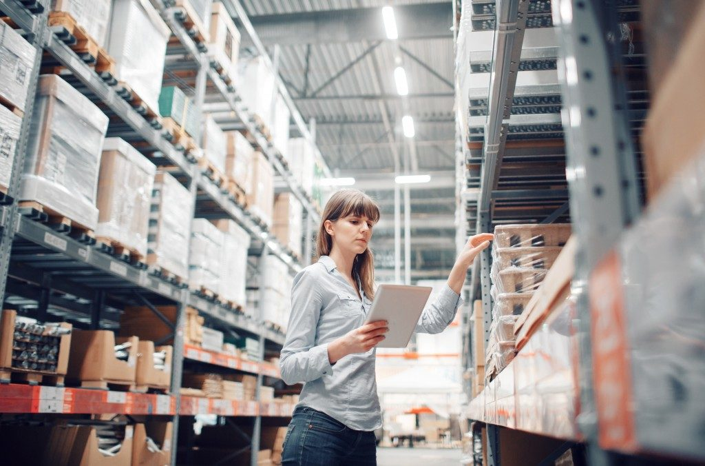 a woman working at a warehouse