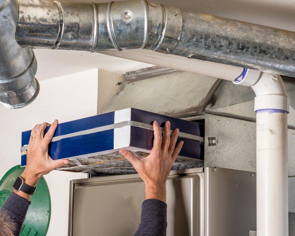 Man placing filter furnace