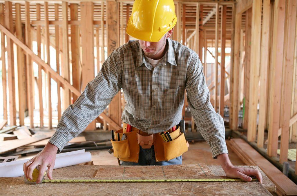 Man measuring plywood