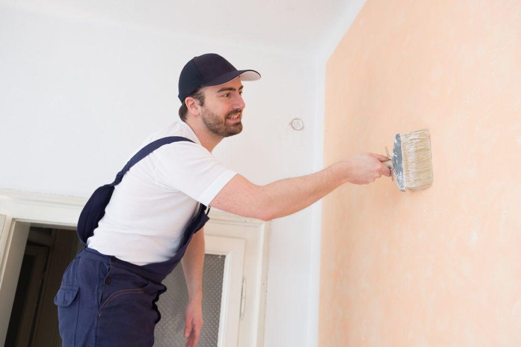 Man reainting the wall
