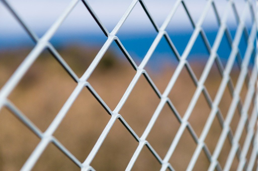 Metallic chain link fence up close