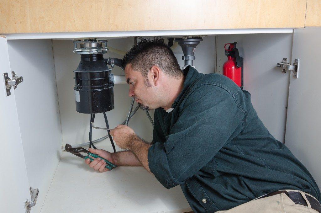 plumber doing maintenance