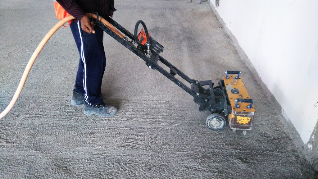 Worker fixing the house floor