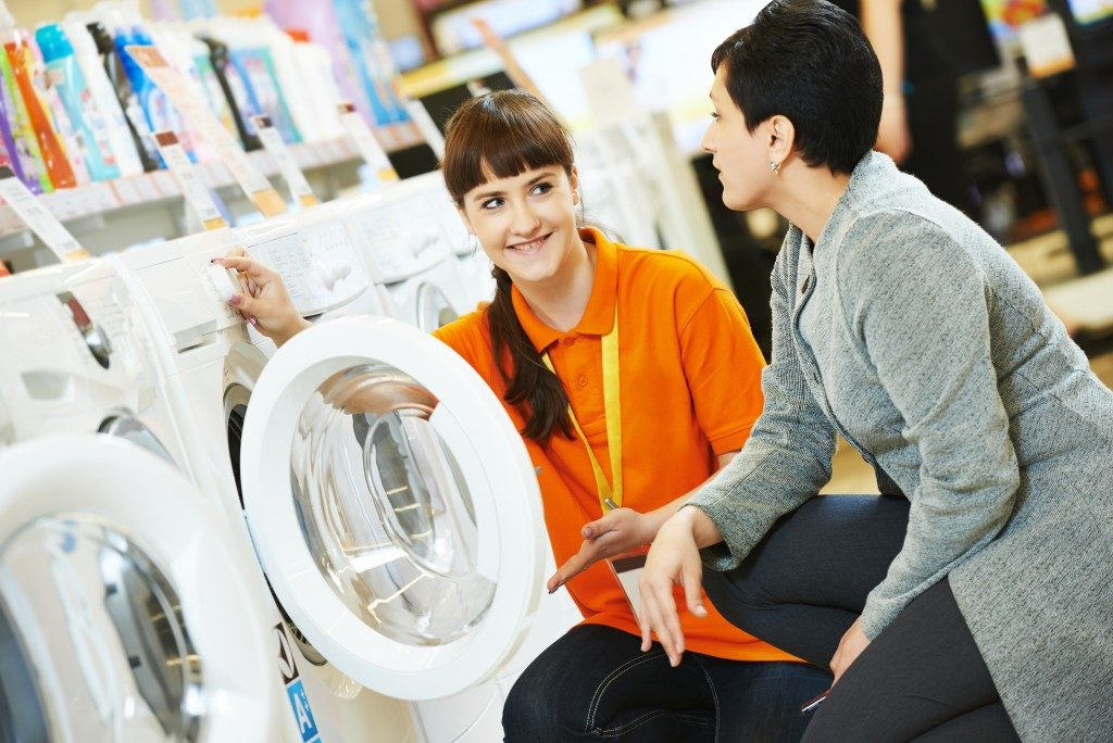 Woman choosing a washing machine