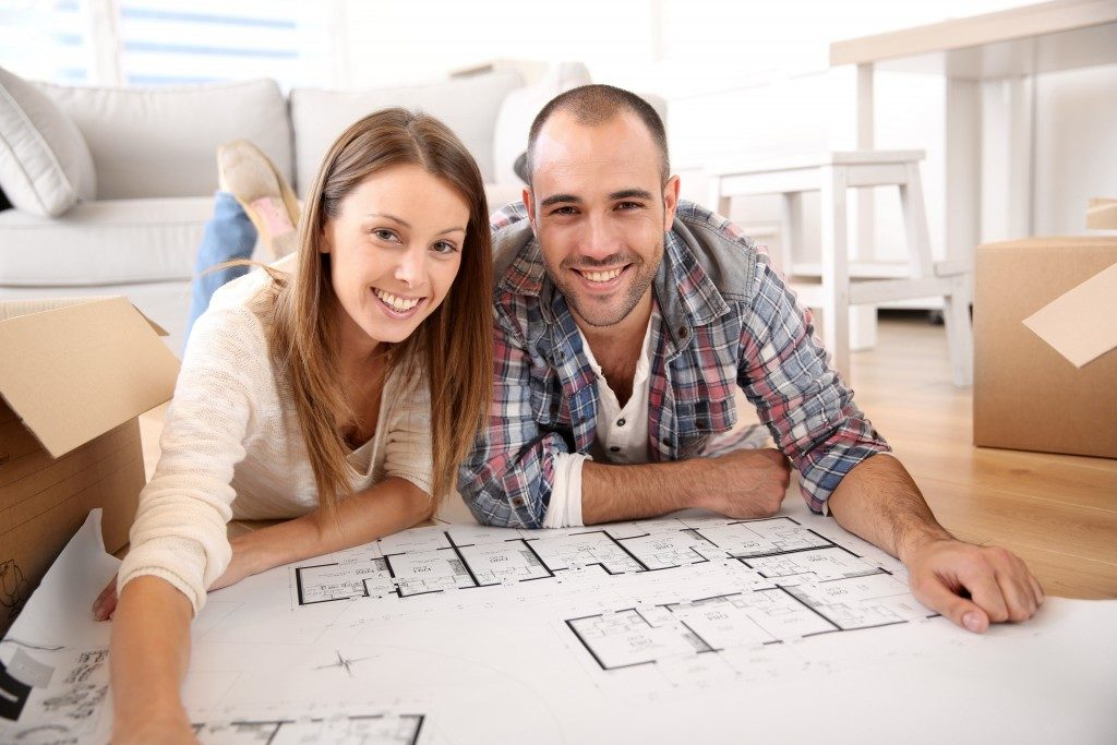 Couple checking the floor plan