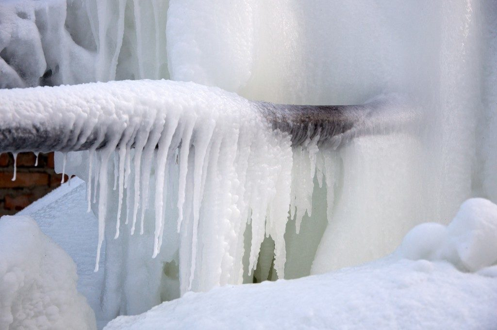 frozen pipes outside a house