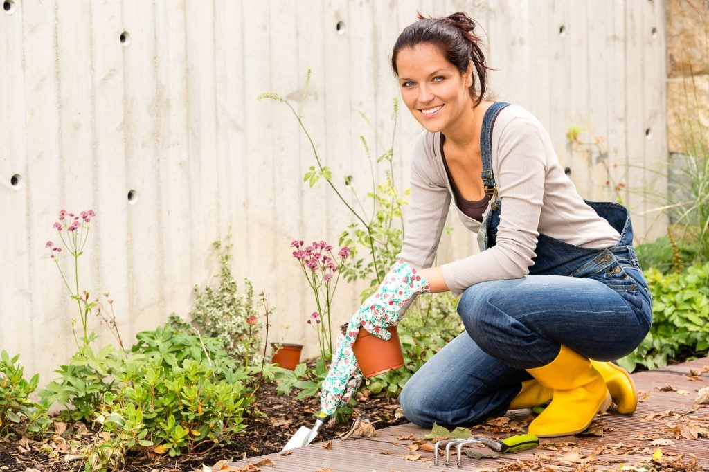 woman gardening on her backyard