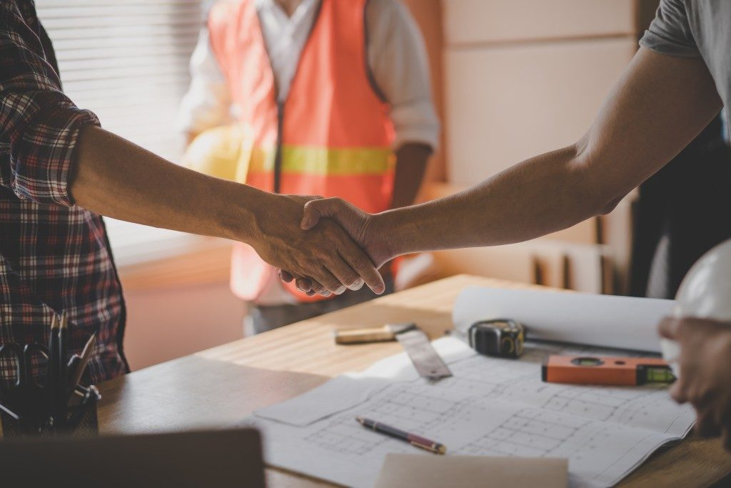 Businessman and client shaking hands