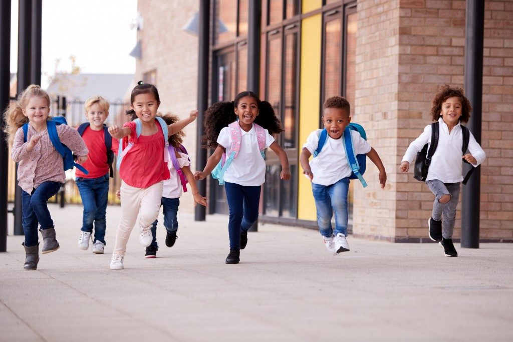 children running on campus