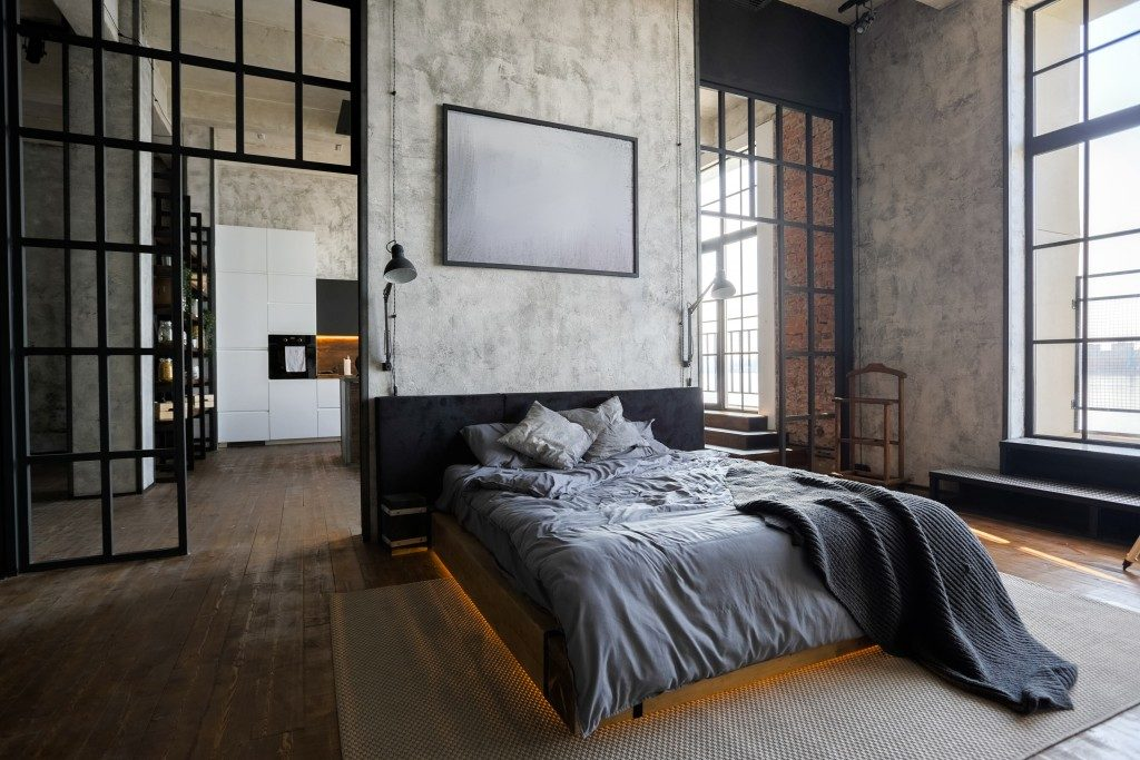 gray bed in a studio type apartment