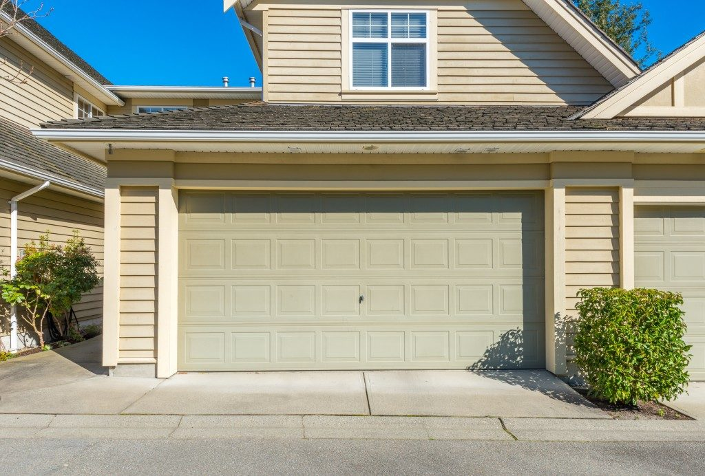 closed garage door of a modern house subdivision