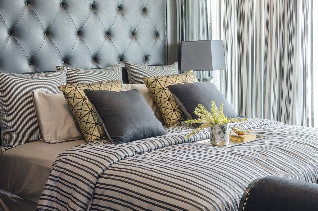 luxury bed with patterns and colored sheets