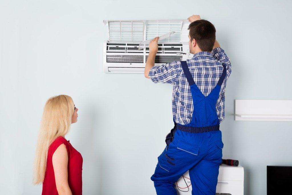 contractor installing air conditioner