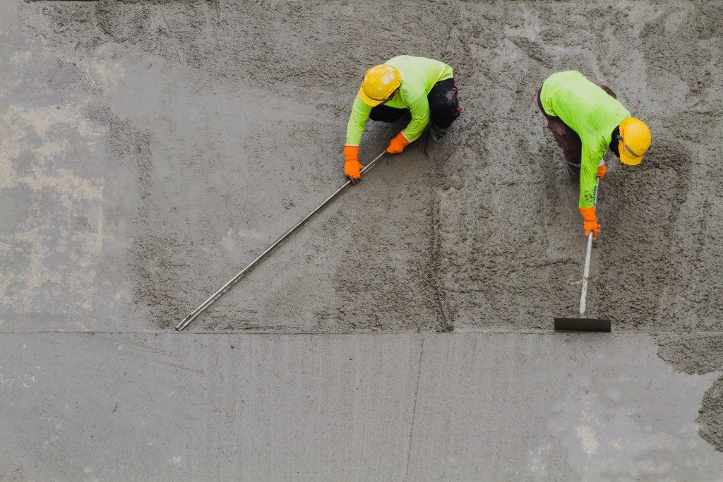 Workers laying down concrete