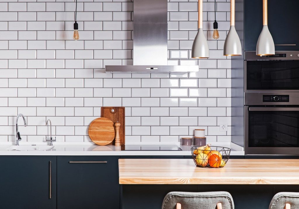 modern kitchen in white tiles and touch of blue