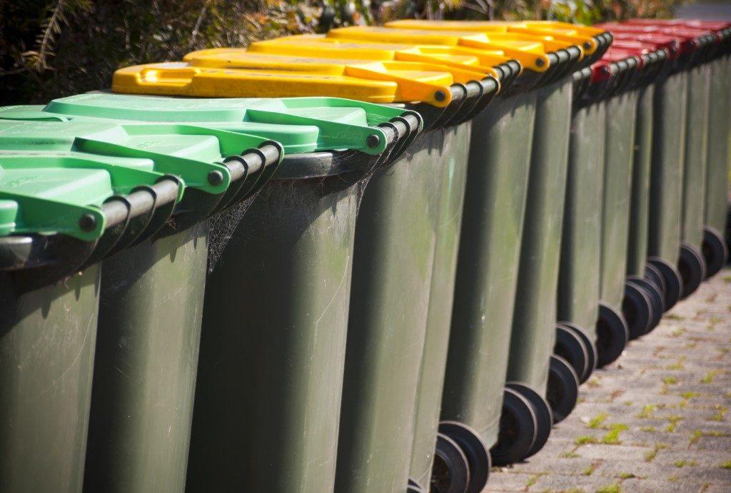 Row of colored trash bins