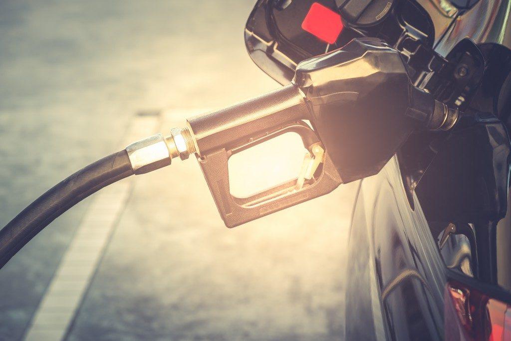 gasoline being put in a car