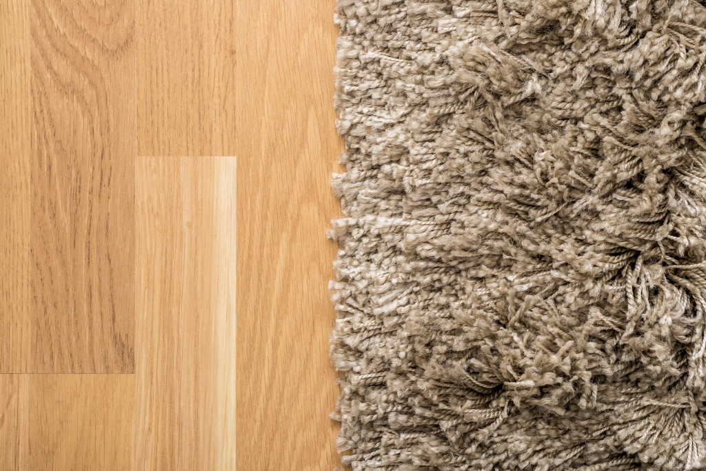 Fluffy carpet on the wooden floor