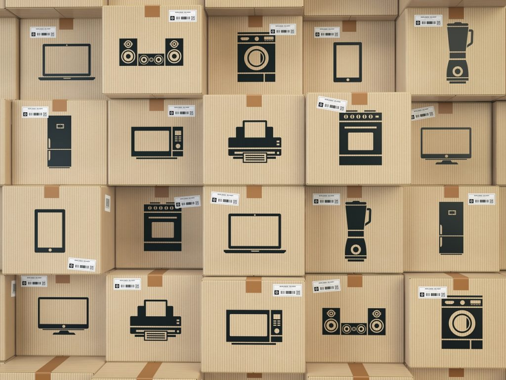 Household kitchen appliances and home electronics in boxes
