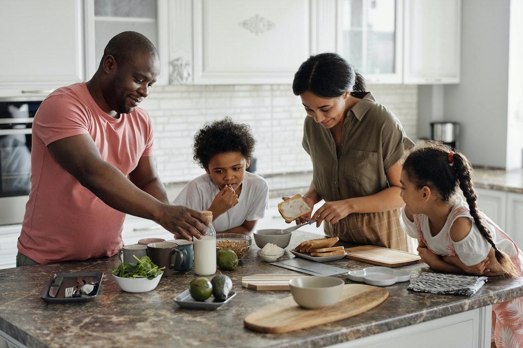 Family making breakfast in kitchen island