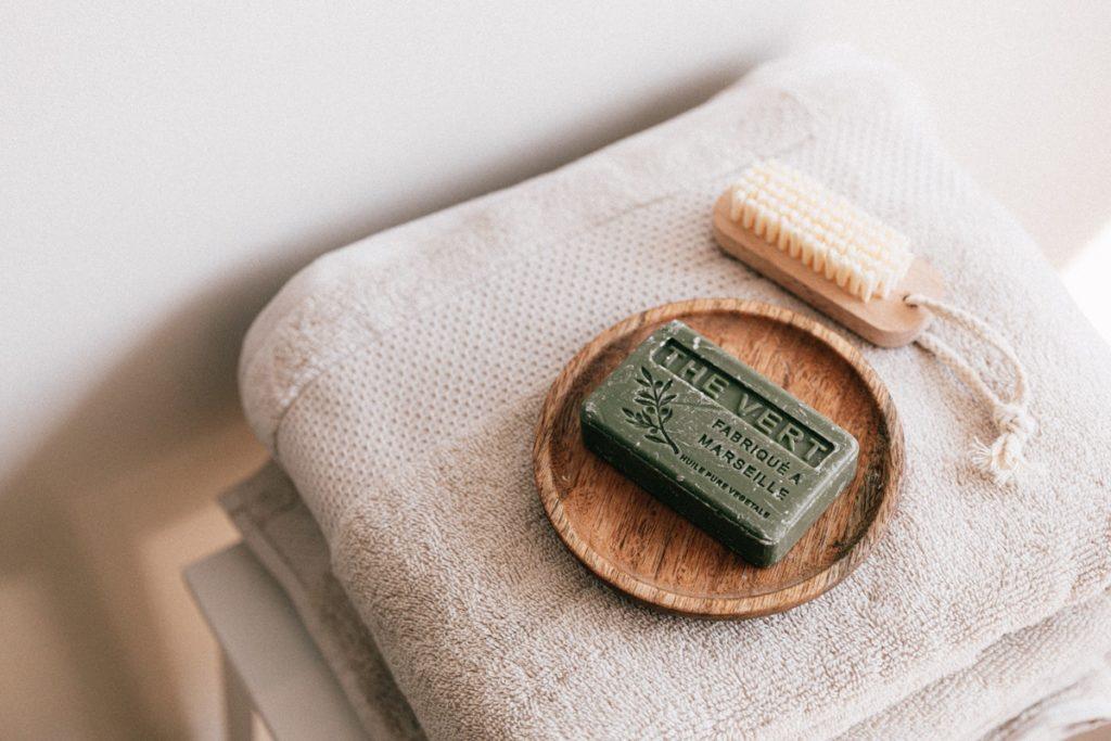 bathroom towel, soap and scrub