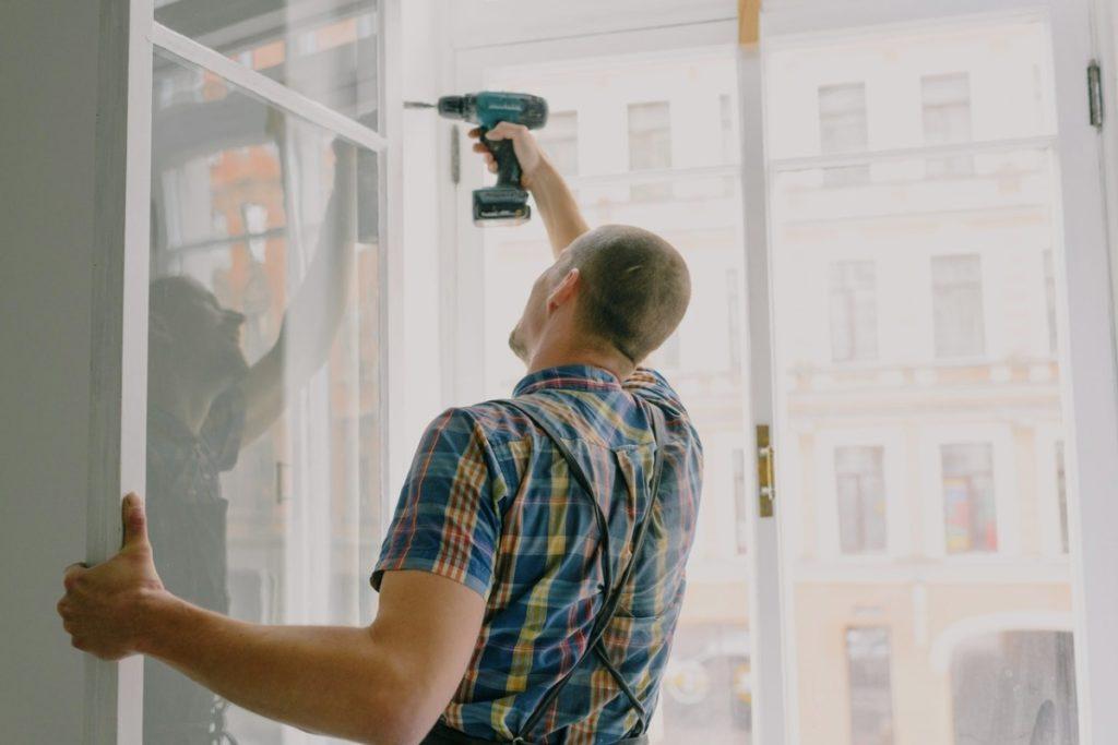 man installing a window panel